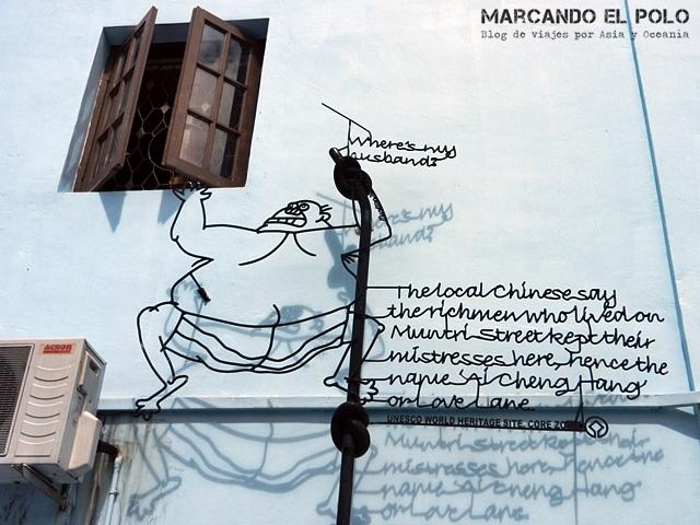 Arte callejero de Penang en hierro - The cheating husband