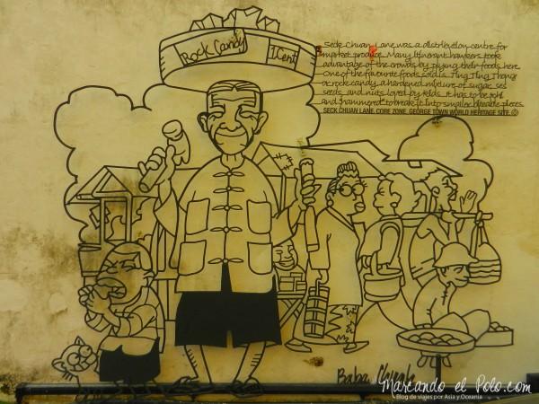 Arte callejero de Penang en hierro - vendedor de caramelos